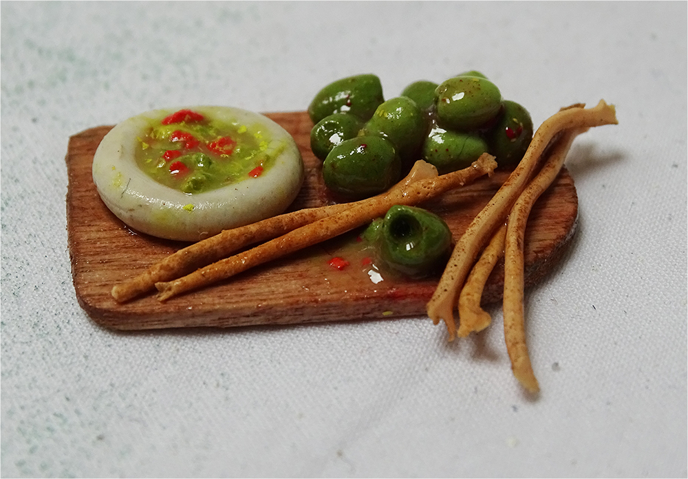 A mini meal of breadsticks, olives and guacamole