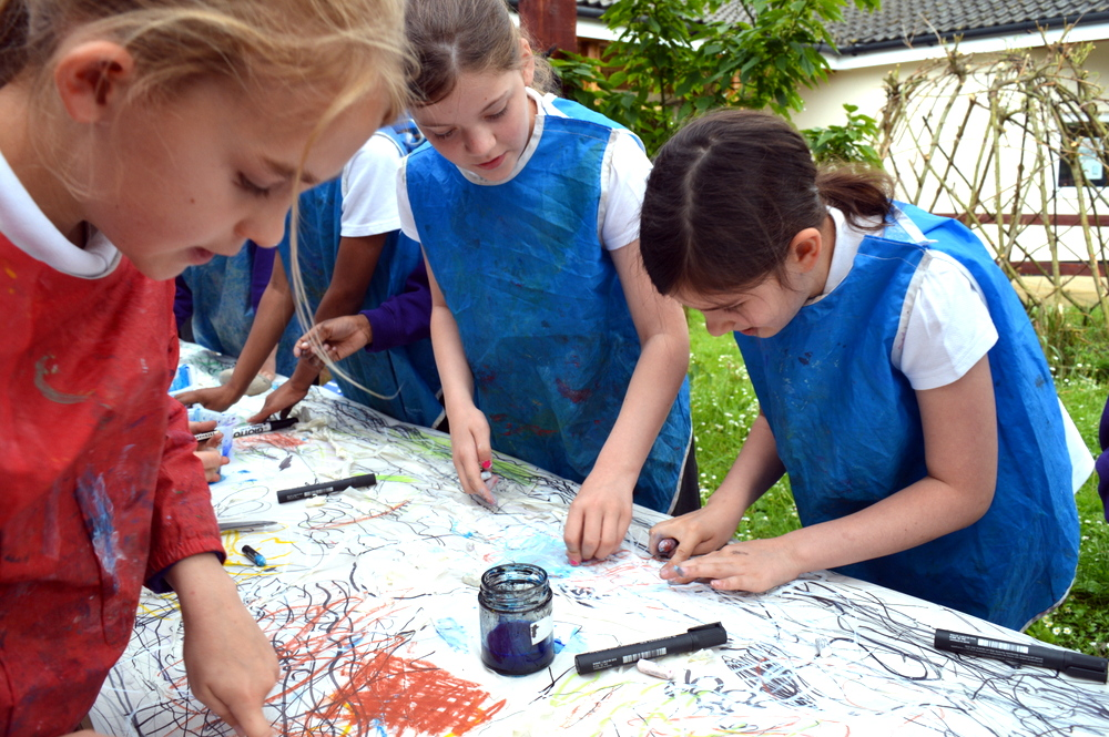 Pupils are then given a selection of oil pastels and encouraged to work energetically with mark making inspired by the water