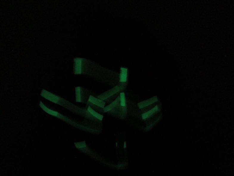 Glow in the dark taped face -Sara Dudman