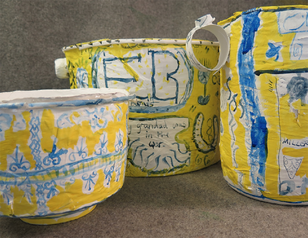 Year 5 Papier-mache bowls inspired by Delft pottery and Grayson Perry's ceramics. Theme- family heritage.