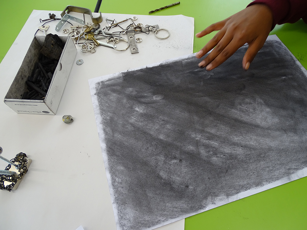 Layering a sheet with charcoal