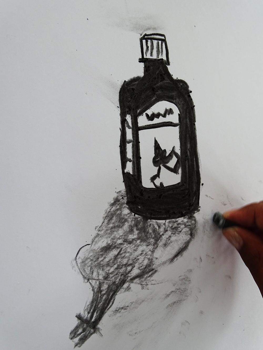 Drawing ink bottle with charcoal