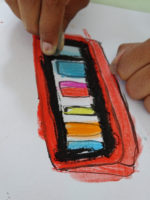 Using ink and quill to draw a paint palette, with pastel colour