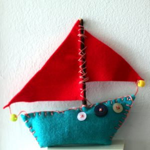 Artist educator Ruth Purdy uses colourful felt in a project sewing boats with adults in care.