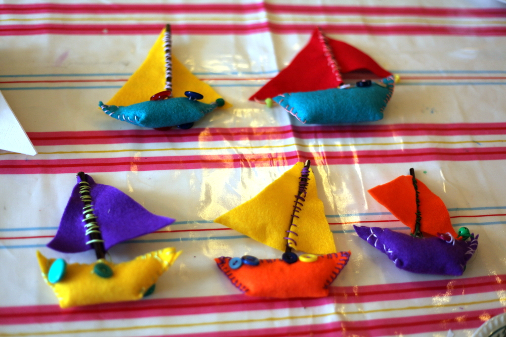 Felt is one of the easiest fabrics to manipulate and provides a wide palette of colour. Artist Ruth Purdy share a process to combine felt pieces with bright embroidery floss, buttons and beads to make colourful sailing boats.