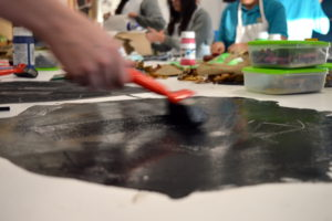 Students enjoyed monoprinting on a large scale by rolling printing ink and acrylic paint directly onto the table and experimenting with ways to take prints.