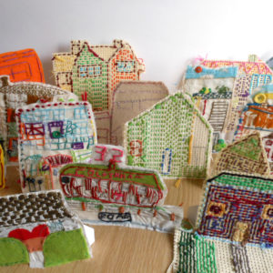 "This resource was developed to to celebrate the character and diversity of the many beautiful stitched houses we received as part of an AccessArt participatory project called the AccessArt Village.  It's a simple way to build a collection of architectural models and allows for lots of different configurations and layouts.  The first step is to create a sewn image of your favourite building using any textile method that you like or by combining methods like printing, painting or fabric crayons and then adding stitch or using free stitching and fabric scraps to create a textured drawing. [themify_button style=""xlarge block"" link=""https://www.accessart.org.uk/the-accessart-village-project-make-a-model-stitched-house/"" color=""#78608e"" text=""#ffffff""]Read More[/themify_button]"