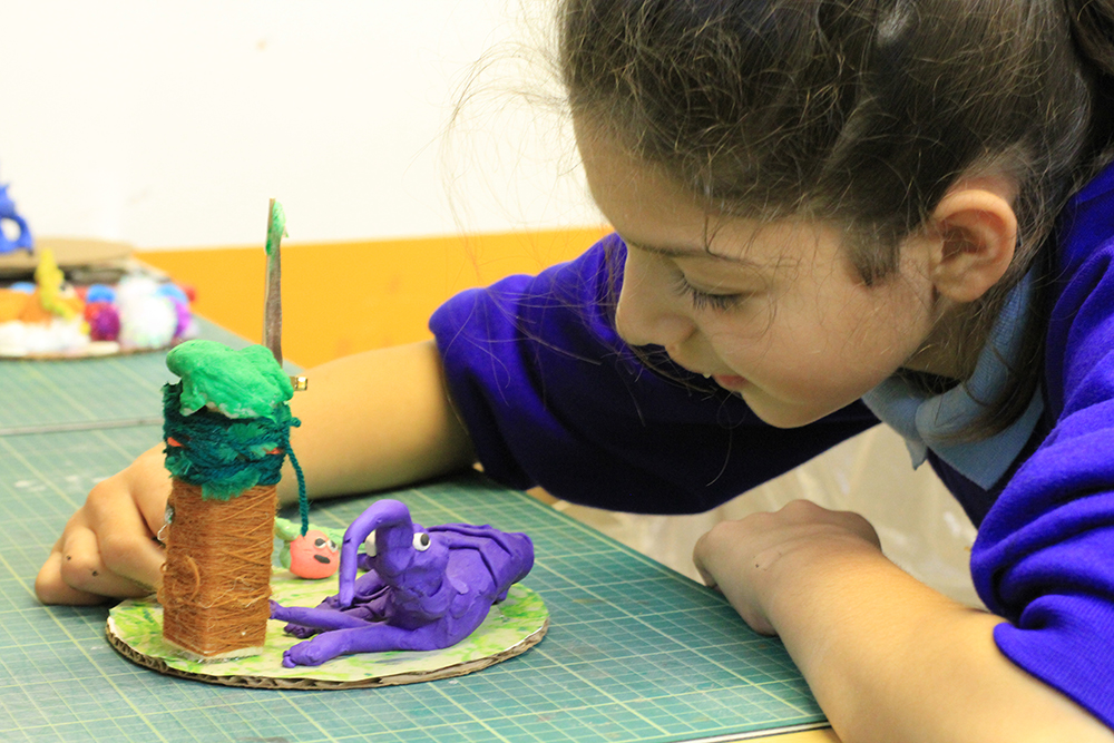 Student with her ant eater sculpture inspired by the Roald Dahl poem The Ant Eater