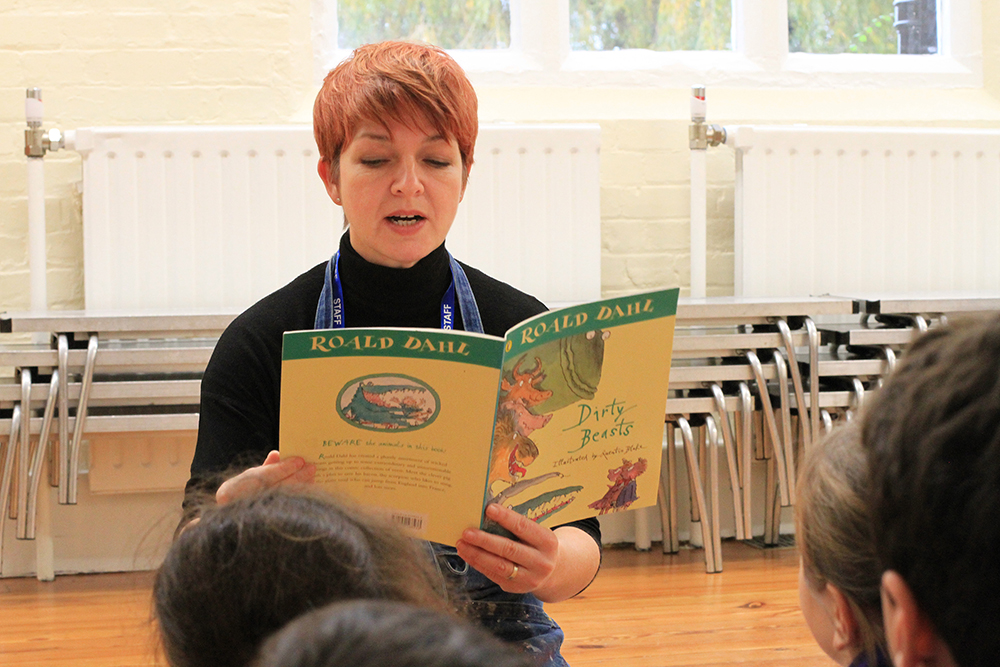 Caption- Sharon Gale reading Dirty Beasts by Roald Dahl to her art club students