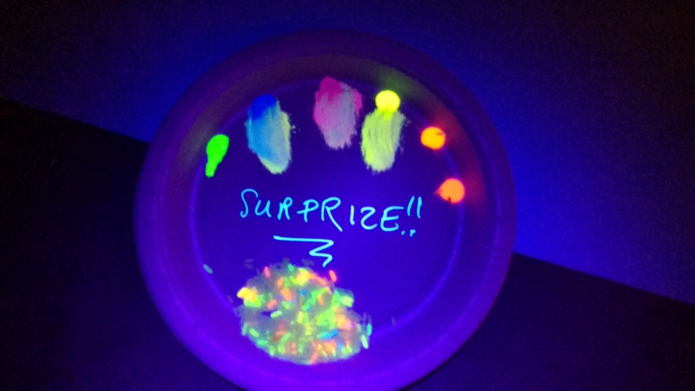 Teenagers Experiment With Glow In The Dark Paint And Rice