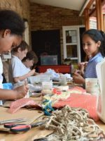 Children start work building reliefs inspired by the