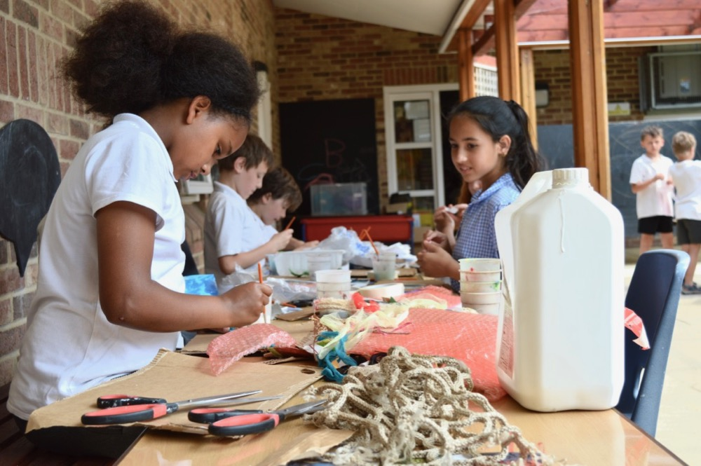 Children start work building reliefs inspired by the 'under the ocean' theme, with a variety of waste materials - SC Ridgefield