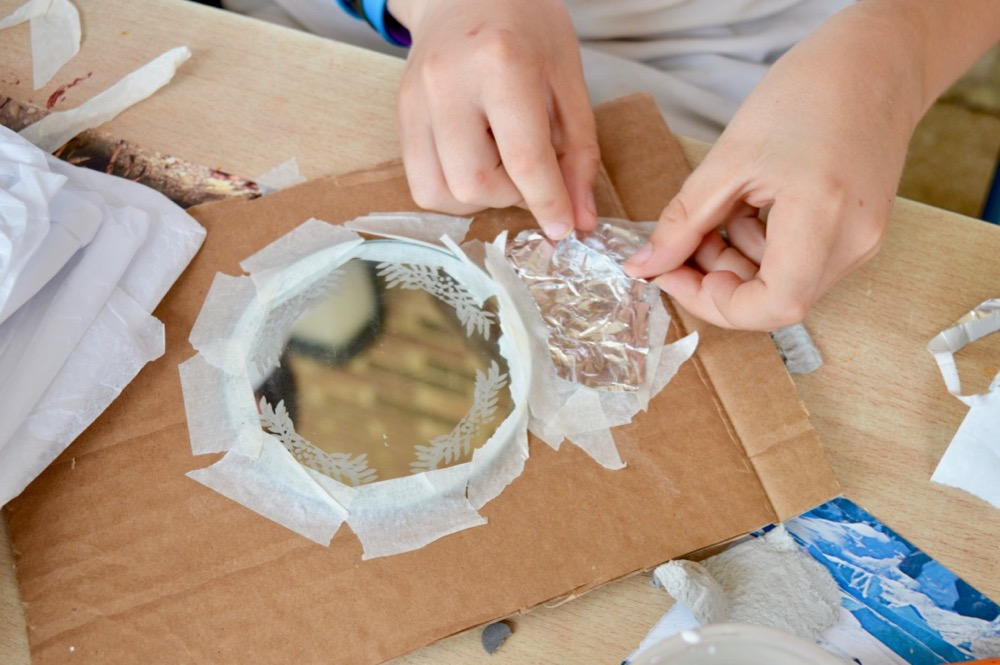 Children chose materials and then started to build their under water relief around the mirror