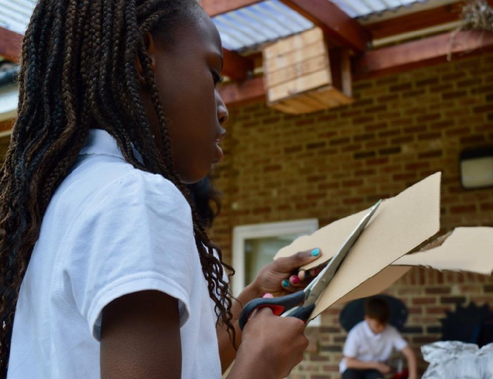 Pupil at Ridgefield using scissors