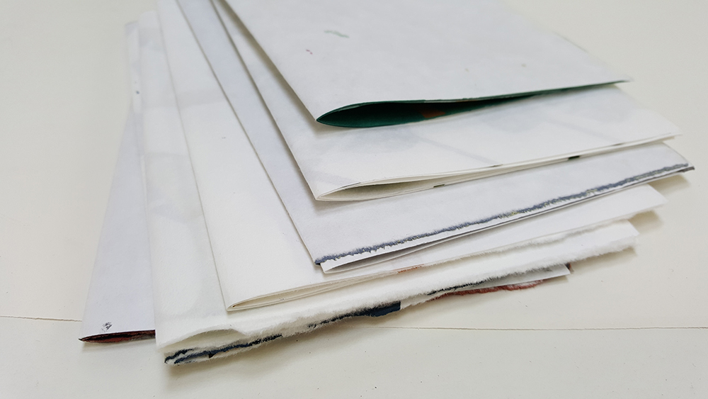 Collect 6 or 8 sheets together to create booklets...