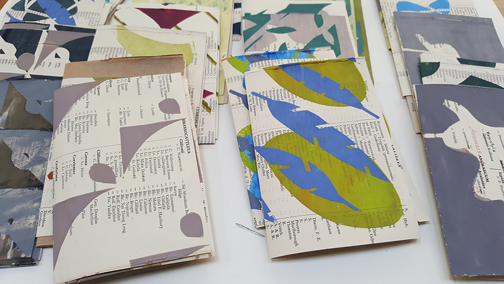 Selection of over printed screenprints, folded in half