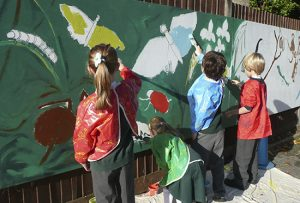 Mural projects engage each child in the school, both in generating ideas for the design and in the fun of the painting. As we work together on the mural, the children's pride in their work grows, generating enthusiasm and excitement in this creative, collective process.