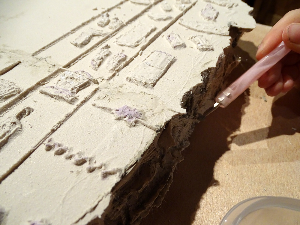 removing clay from the plaster