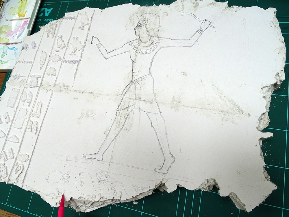 drawing Egyptian imagery on the plaster