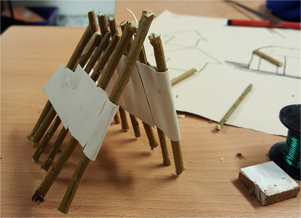 Using paper tape and sticks as a construction material