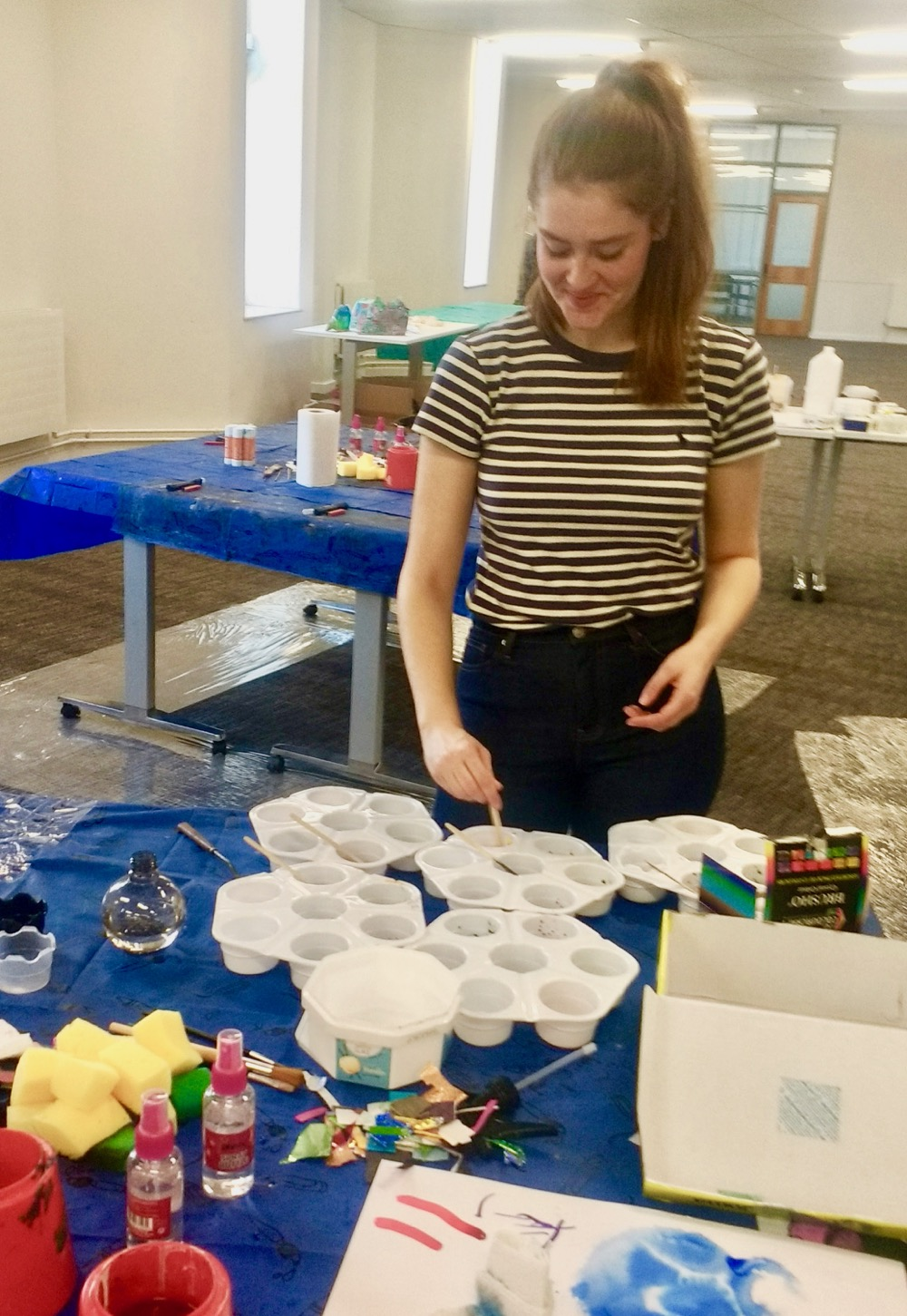 Lilly Feeney, from Inspire: Culture Learning and Libraries – who supported the activity – preparing Brusho Inks, ready for pupils from Berry Hill Primary