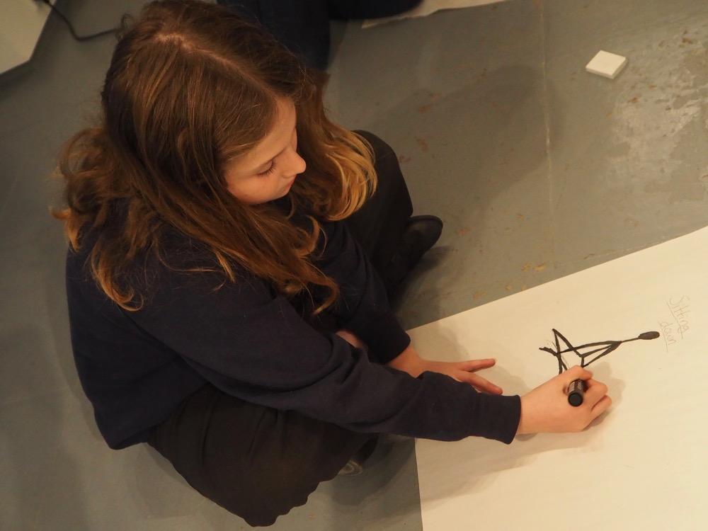 Sitting and Drawing a Cross-legged Figure