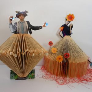 """Artist Andrea Butler makes use of second-hand books as creative material. <a href=""""http://""""/paperback-figures-collaged-relief-sculptures/"""""""" class=""""shortcode button    """"xlarge"""" style=""""background-color: """"#78608e"""";color: """"#ffffff"""";"""">Read More</a>"""