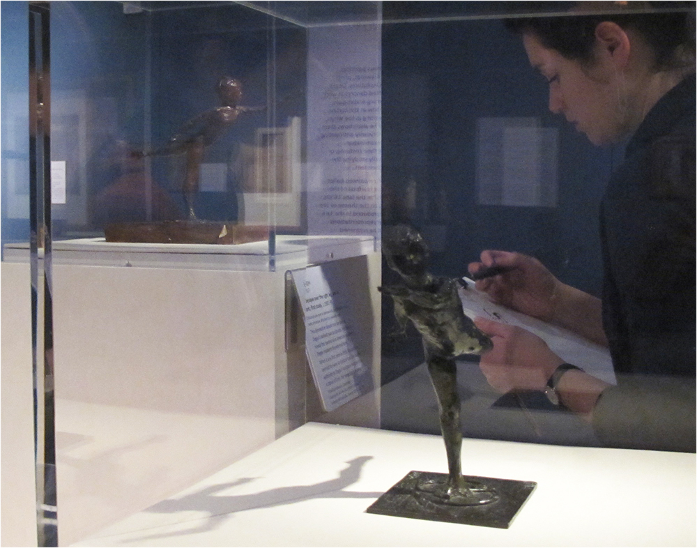 Teacher drawing from Degas sculptures: Arabesque over the Right Leg, Left Arm in Front, First Study, copper alloy C.119 (foreground) Arabesque over the Right Leg, Left Arm in Front, First Study, coloured wax, C.114 (background)