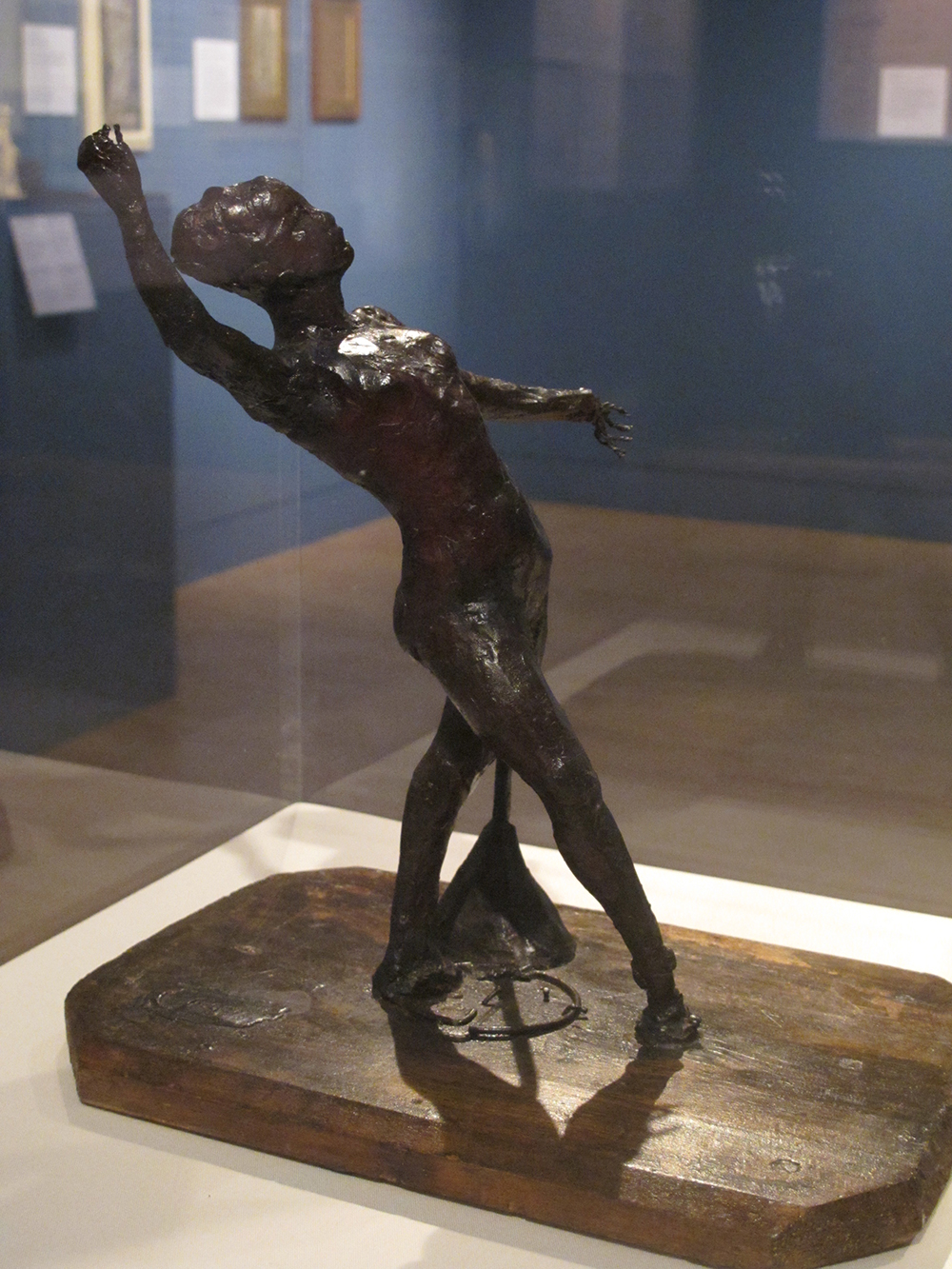 Dancer with a Tambourine, 1880s, Coloured wax over a commercially prefabricated metal wire armature, attached the a wooden base
