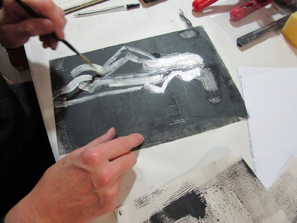 A teacher starts by looking at her drawing etching into her inked up plate - SC Fitz