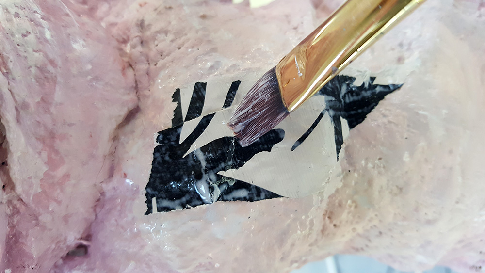use a brush and pva glue to stick the collaged pieces over the modroc
