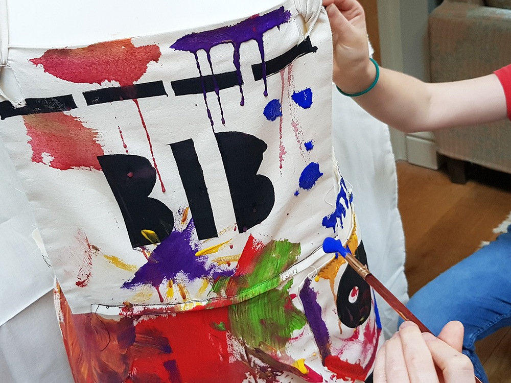 painting the canvas of the dungarees