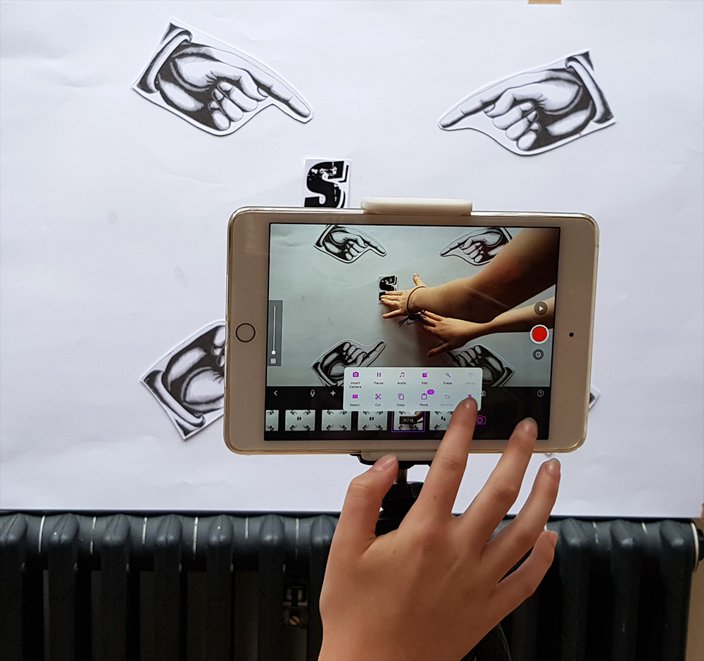 printed font for stop motion animation, attached by magnets to a whiteboard, filming on an ipad