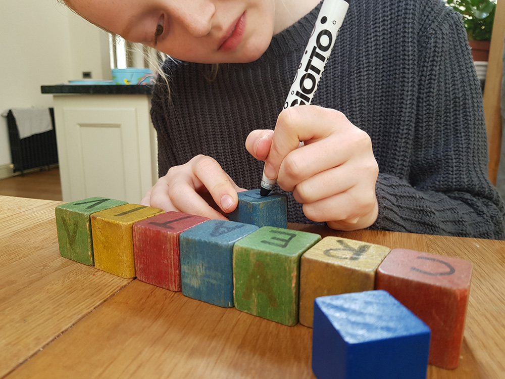 Writing letters on building blocks