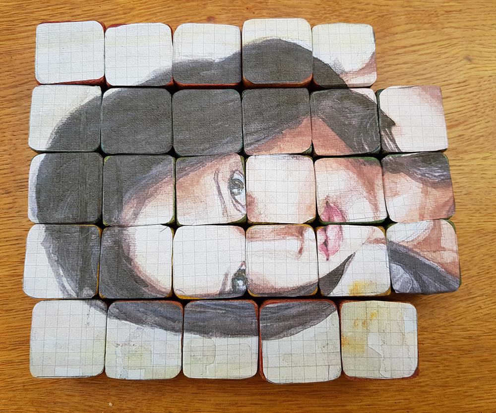 Portrait stuck on building blocks to form a puzzle