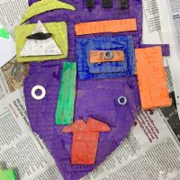 Abstract face relief sculptures by Sharon Gale