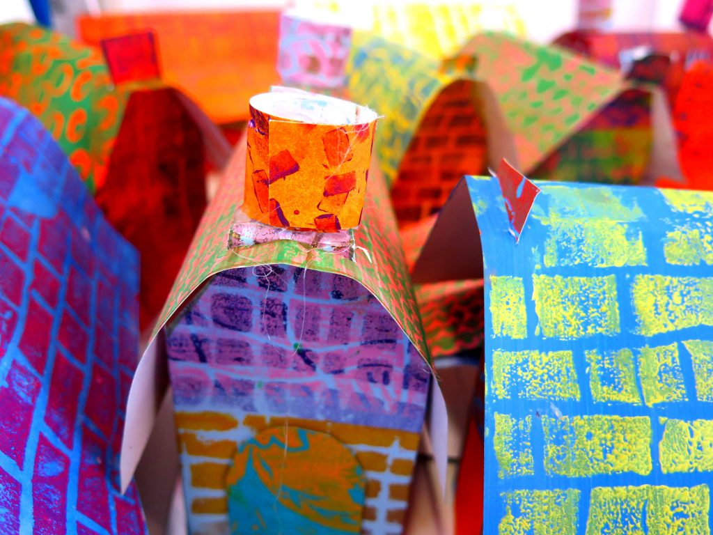 Paper houses made from printed papers
