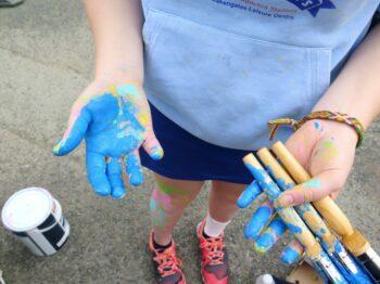 blue paint on hands
