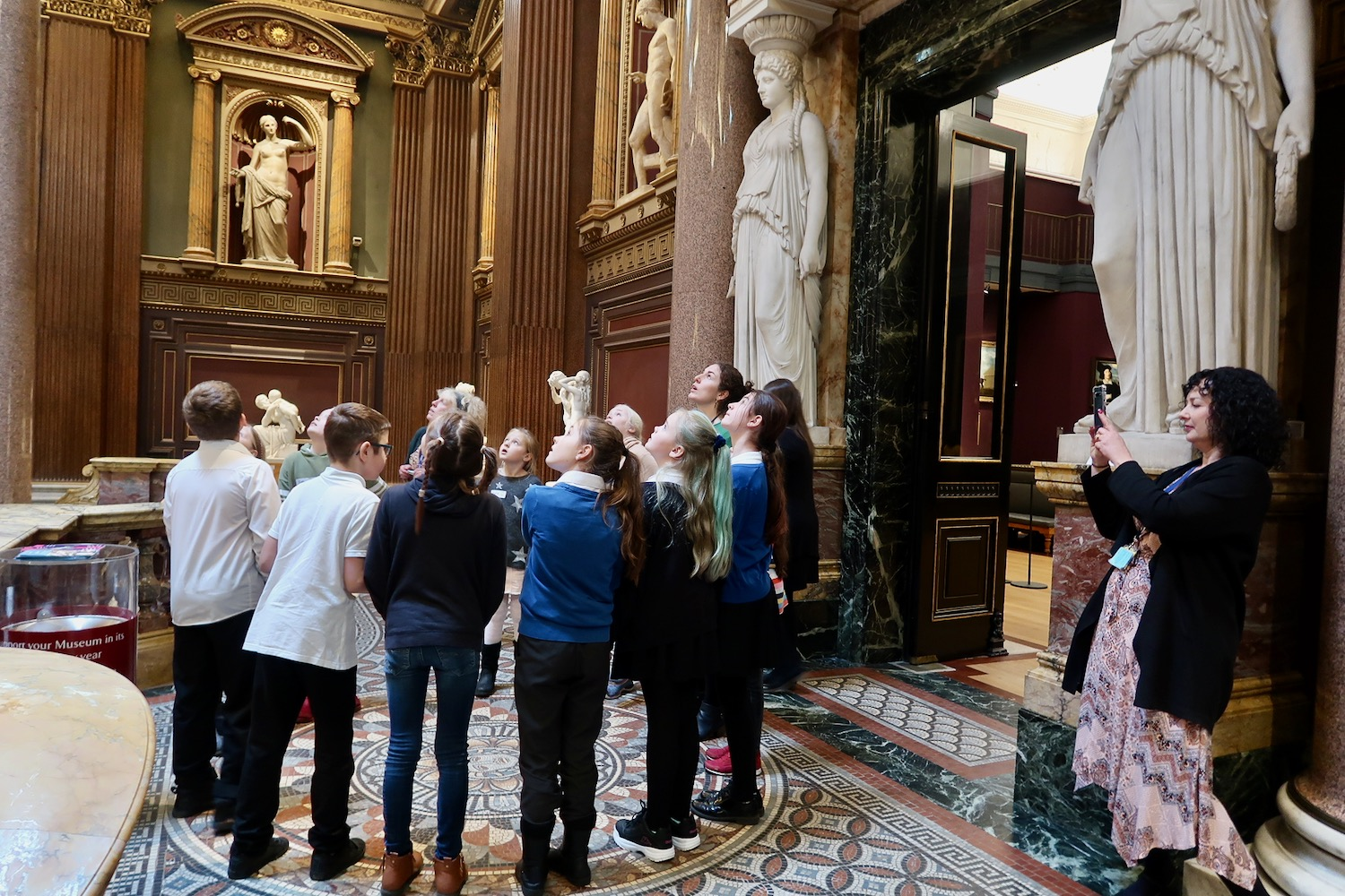 Pupils from Morley Memorial School and St Peters juniors looking at the grand entrance of the Fitzwilliam Museum, Cambridge