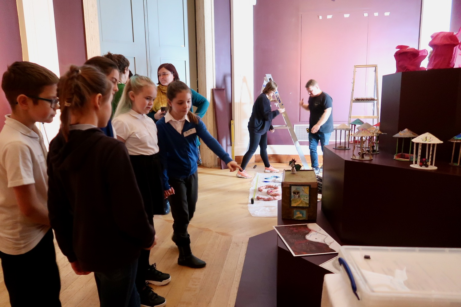 In the Octagon Gallery pupils are greeted by the installation team Charis Millett and Jamie who are installing their work