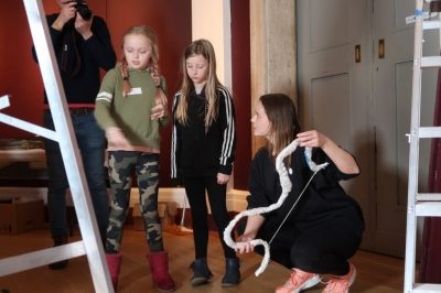 Young artists from Morley Memorial Primary School, Cambridge and St Peters C of E Junior School, Wisbech, Cambridgeshire, came to see their work being installed by Charis and Jamie from the museum.