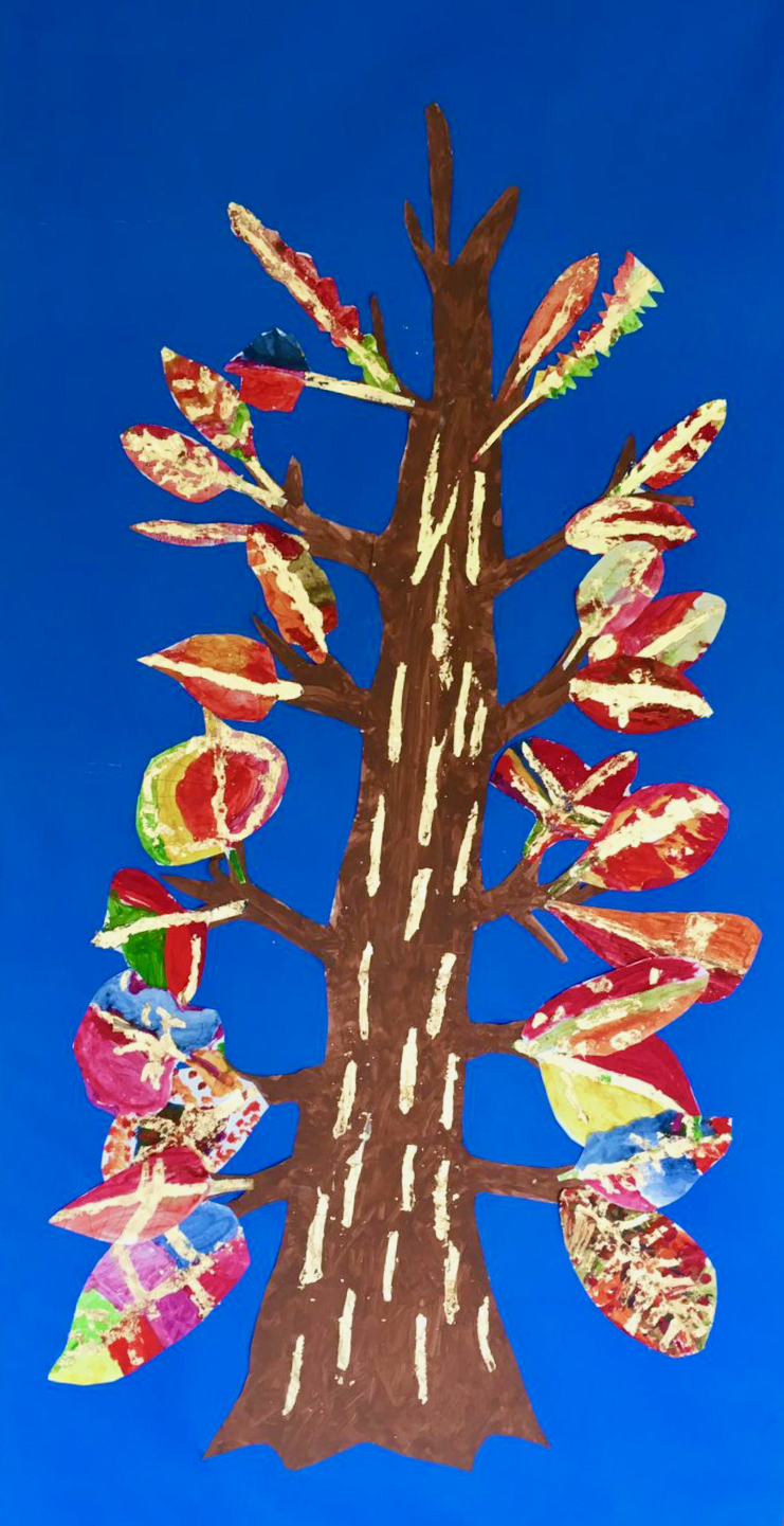 A tall, thin symmetrical tree with fifteen, large leaves down one side and mirrored with fifteen on the other. The leaves are brightly coloured and have gold leaf enhancements. The tree is on a bright blue background with a brown trunk