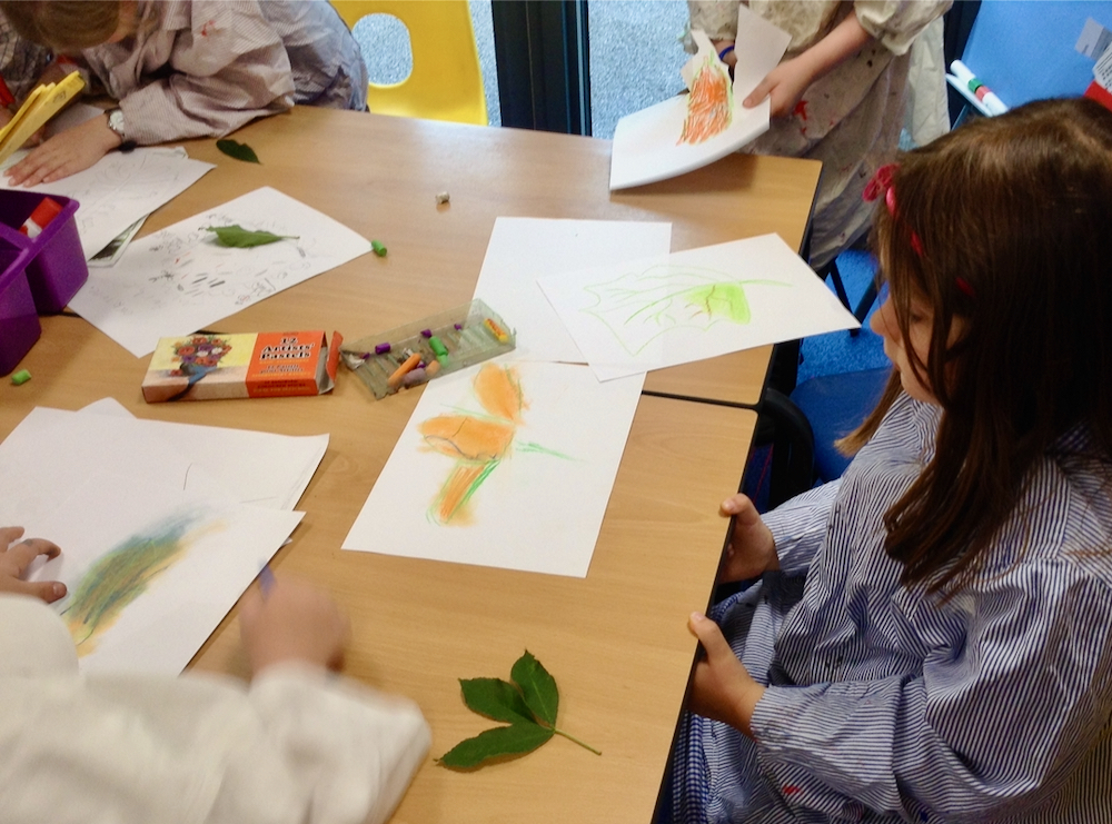 Year Two Girl at Hauxton Primary School drawing leaves with pastels with Pamela Stewart for Inspire