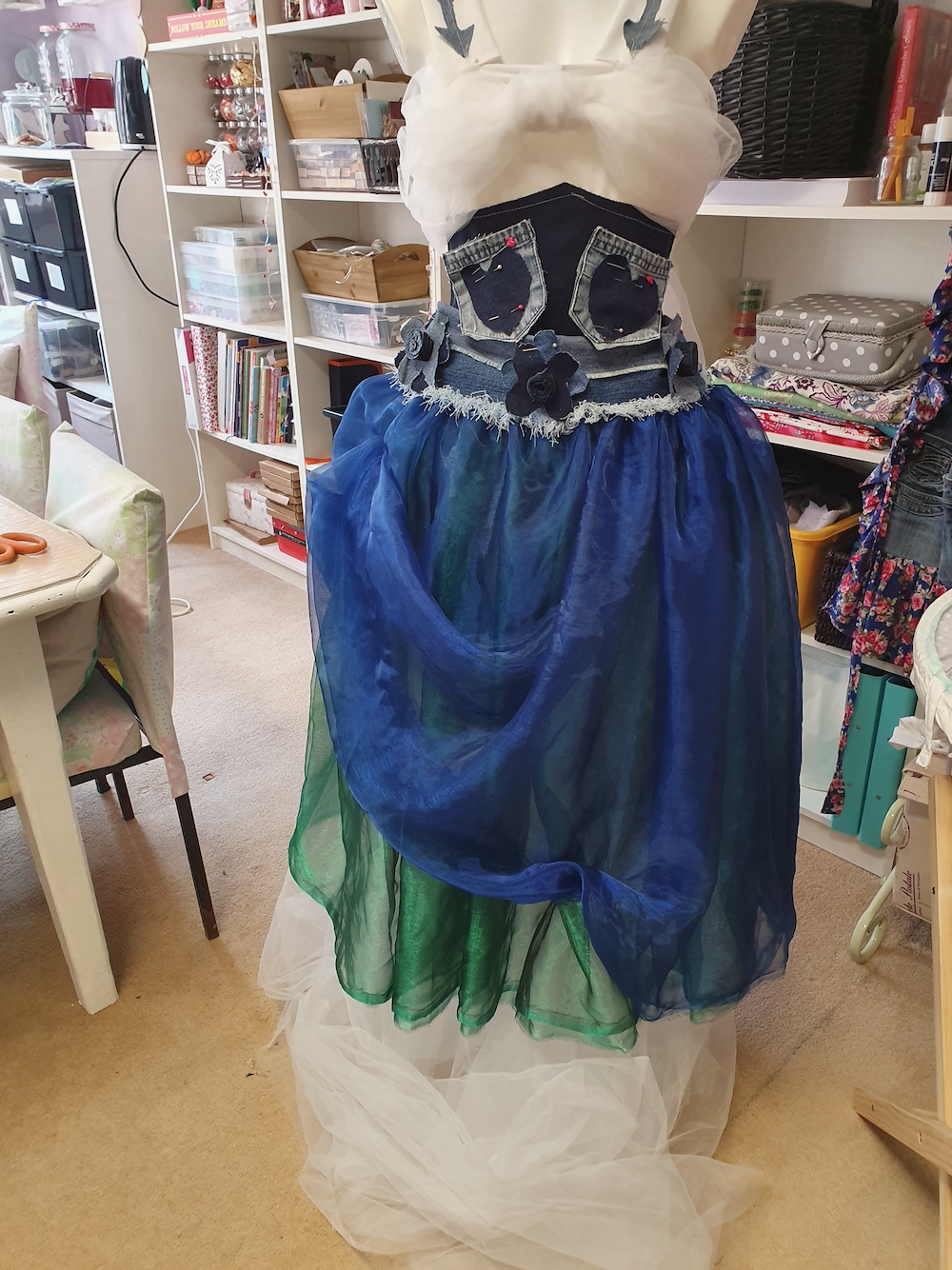 Psyche's dress in mid-construction with blue organza skirt and denim pockets sewn onto the bodice by Fitzy Peters with Natalie Bailey - Inspire