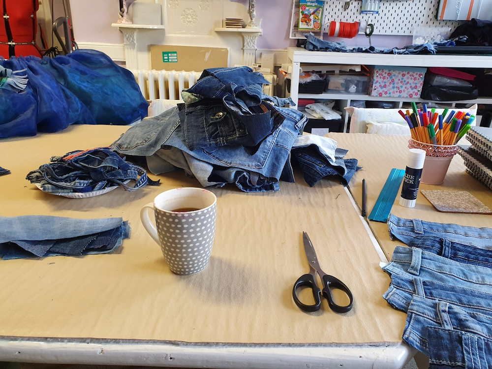 Pile of denim ready to be transformed into Psyche's dress with teacher Natalie Bailey - Fitzy Peters - Inspire