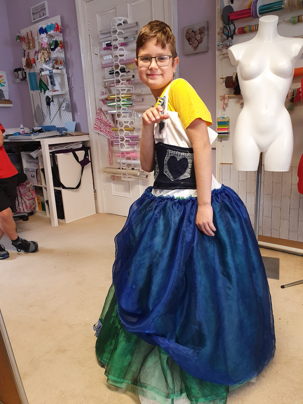 Having fun with Psyche's dress! A boy playfully models the dress