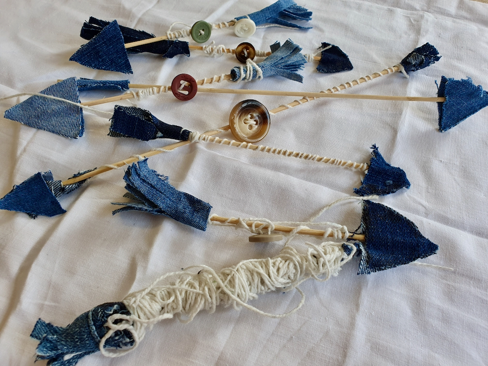 A stash of arrows made by the Fitzy Peters in denim, string and wooden dowel - Natalie Bailey - Fitzy Peters