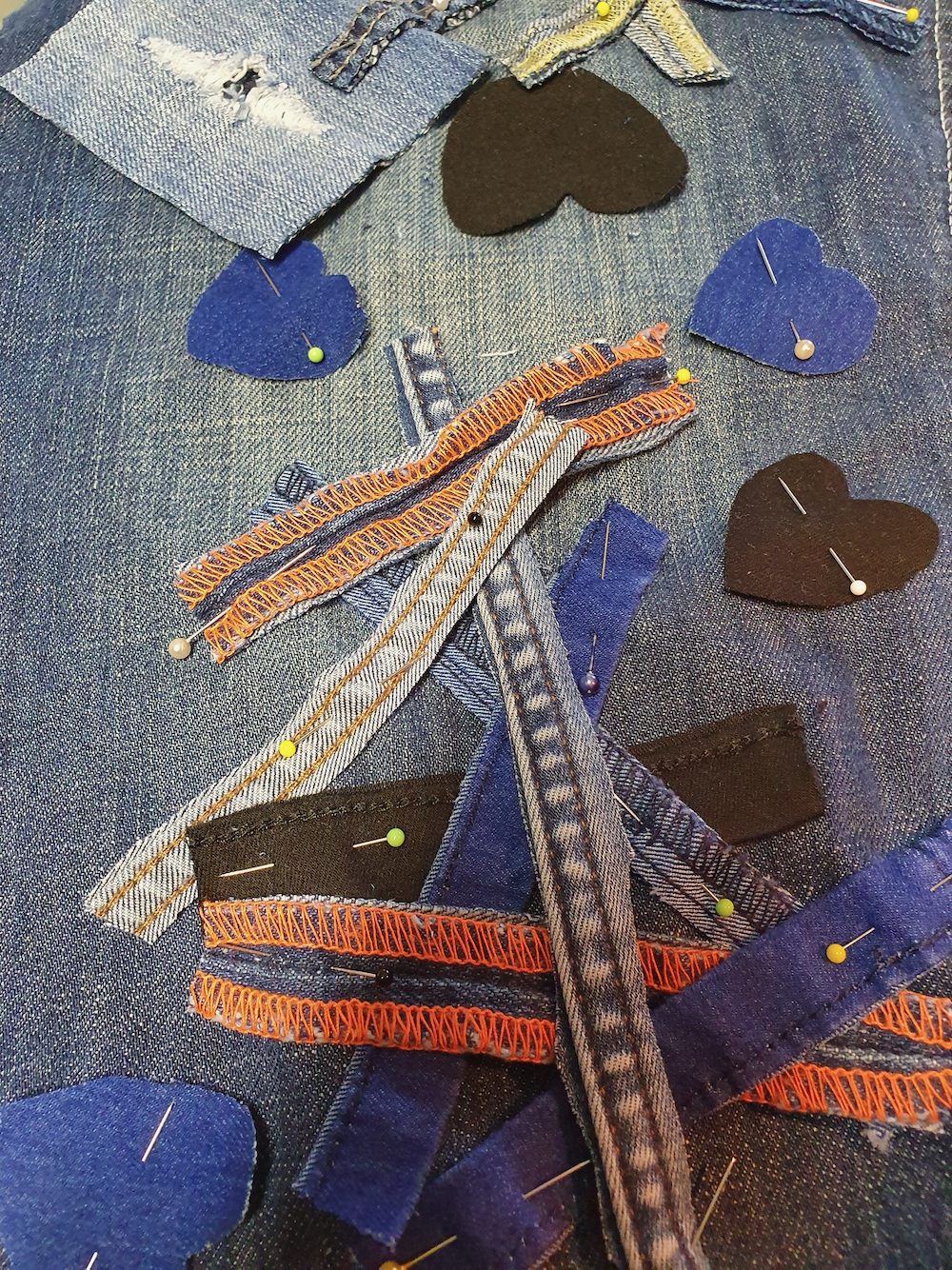 Skirt panels pinned into place (hearts made of denim pinned onto a denim panel by the Fitzy Peters with Natalie Bailey- Psyche's Resilience -