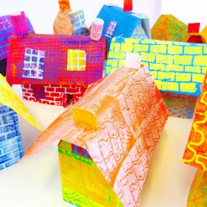 "In this post children use found materials as printing blocks to create colourful patterned papers. The papers are then used to construct 3-dimensional paper houses.  The houses are assembled collaboratively to create a village like display and are then photographed; giving the opportunity for the children to develop their photography and computer editing skills.  [themify_button style=""xlarge block"" link=""https://www.accessart.org.uk/printed-houses/"" color=""#78608e"" text=""#ffffff""]Read More[/themify_button]"