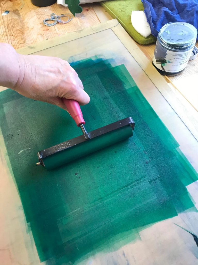 rolling out green ink onto board